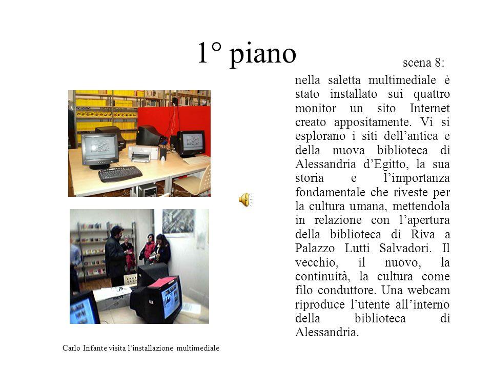 scena 8: nella saletta multimediale è stato installato sui quattro monitor un sito Internet creato appositamente.