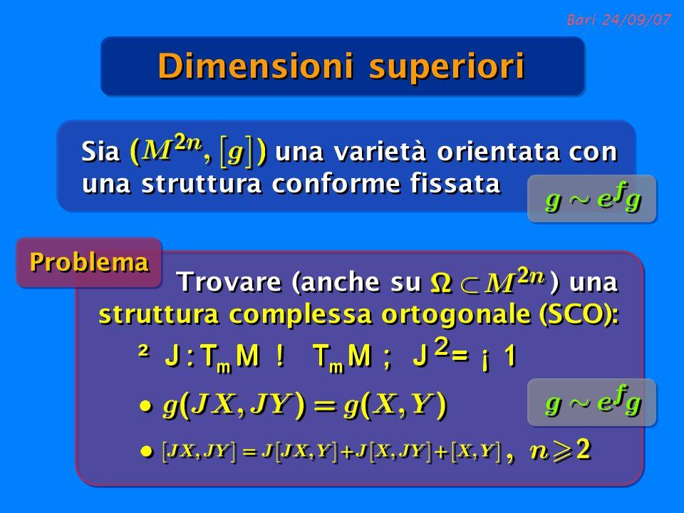 Bari 24/09/07 Sia una varietà orientata con una struttura conforme fissata Problema Dimensioni superiori Trovare (anche su ) una struttura complessa o