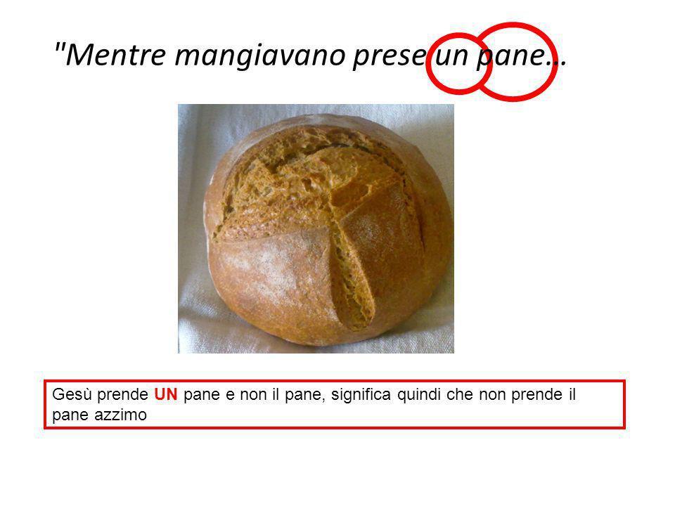 Gesù prende UN pane e non il pane, significa quindi che non prende il pane azzimo