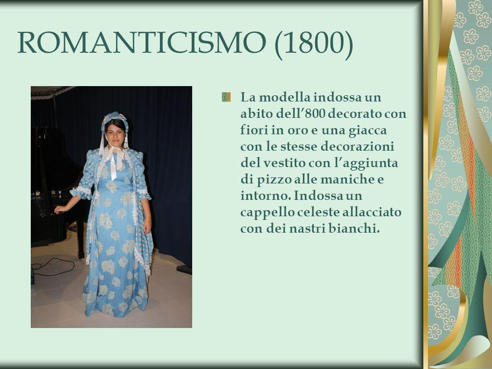 ROMANTICISMO (1800) La modella indossa un abito dell800 decorato con fiori in oro e una giacca con le stesse decorazioni del vestito con laggiunta di