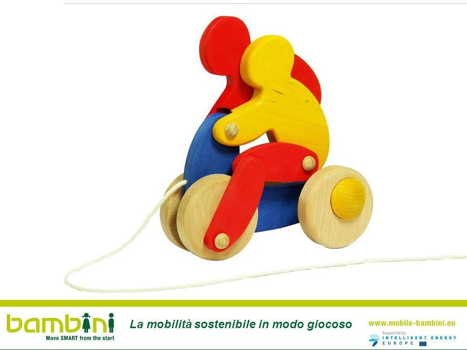 I bambini viaggiano sicuri nella bici- roulettes (bicirimorchio)