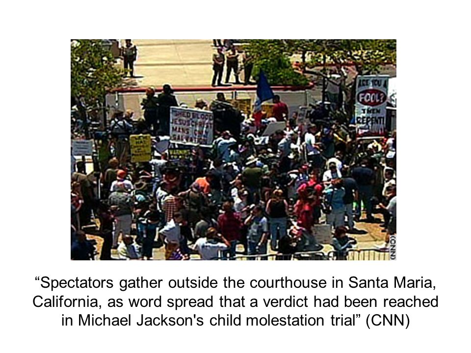Spectators gather outside the courthouse in Santa Maria, California, as word spread that a verdict had been reached in Michael Jackson's child molesta