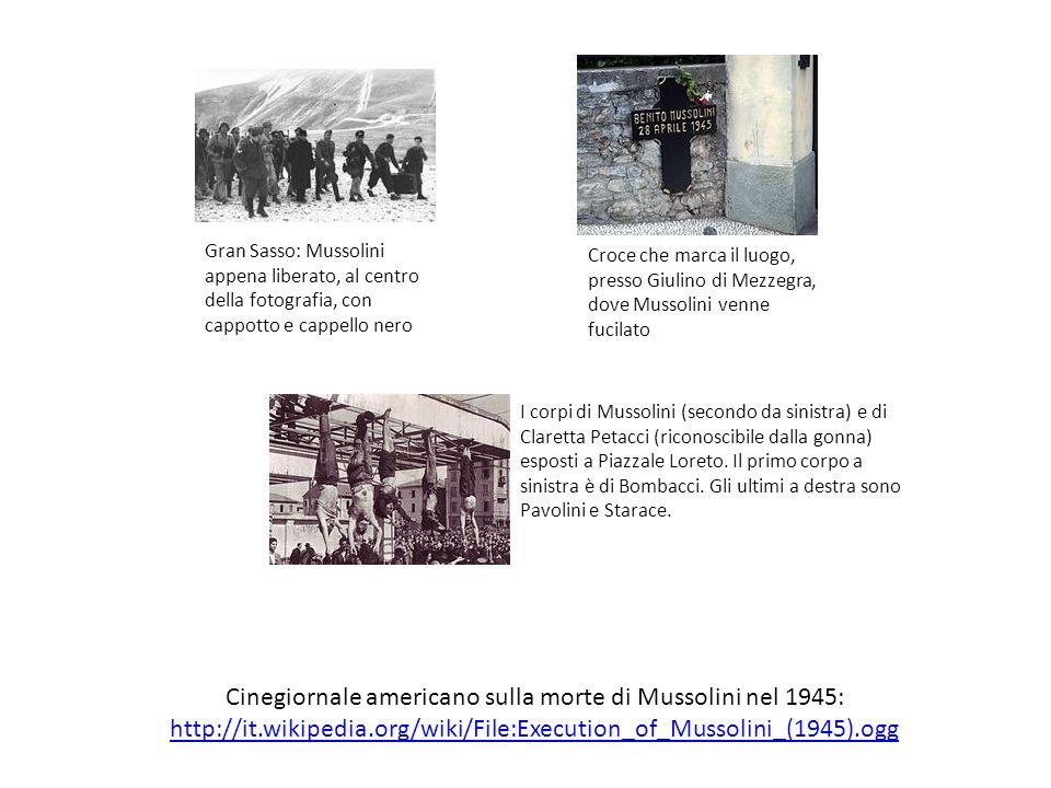 Gran Sasso: Mussolini appena liberato, al centro della fotografia, con cappotto e cappello nero Croce che marca il luogo, presso Giulino di Mezzegra,
