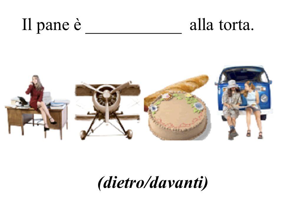 Il pane è ___________ alla torta. (dietro/davanti)