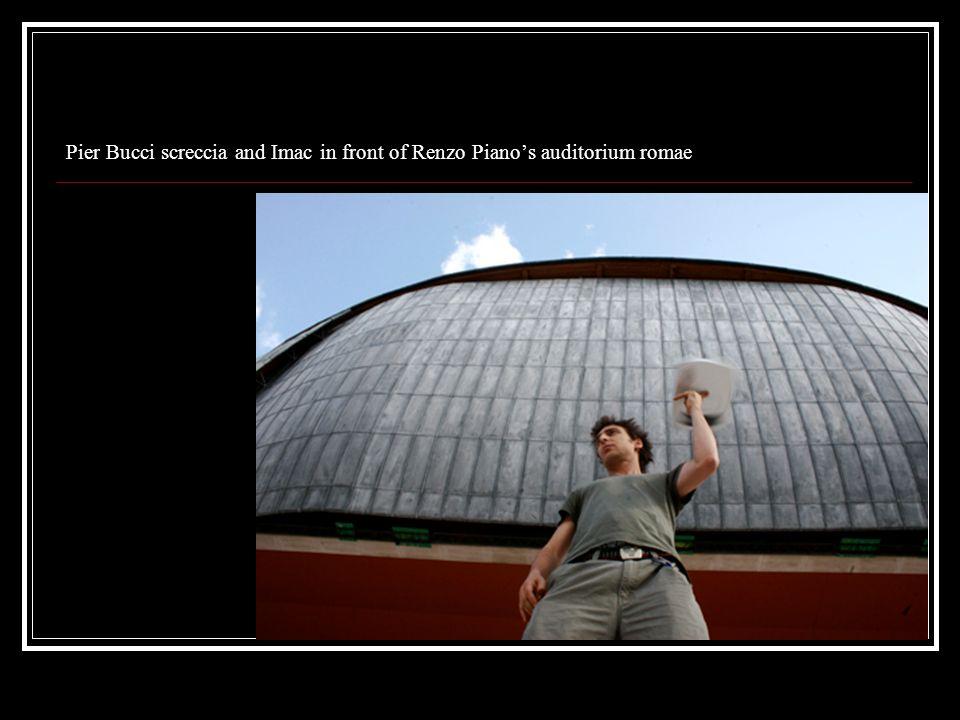 Pier Bucci screccia and Imac in front of Renzo Pianos auditorium romae