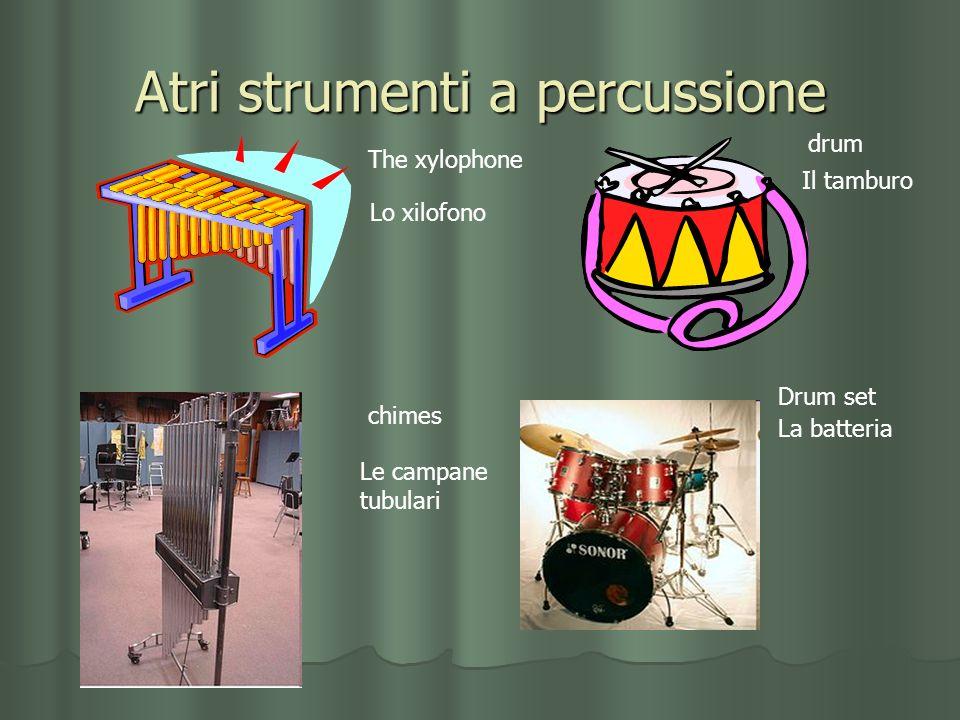 Atri strumenti a percussione The xylophone Lo xilofono drum Il tamburo chimes Le campane tubulari Drum set La batteria