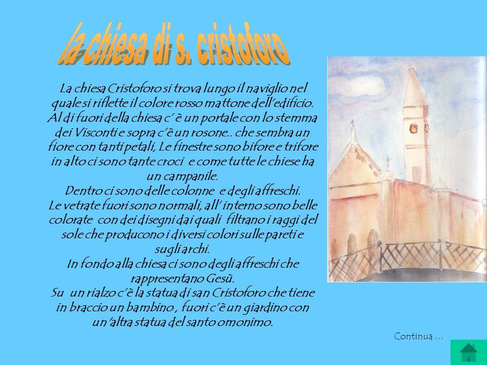 La chiesa Cristoforo si trova lungo il naviglio nel quale si riflette il colore rosso mattone delledificio.
