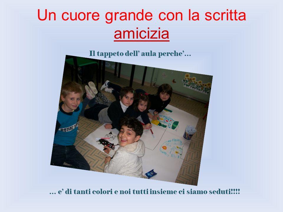 Un cuore grande con la scritta amicizia Il tappeto dell aula perche… … e di tanti colori e noi tutti insieme ci siamo seduti!!!!