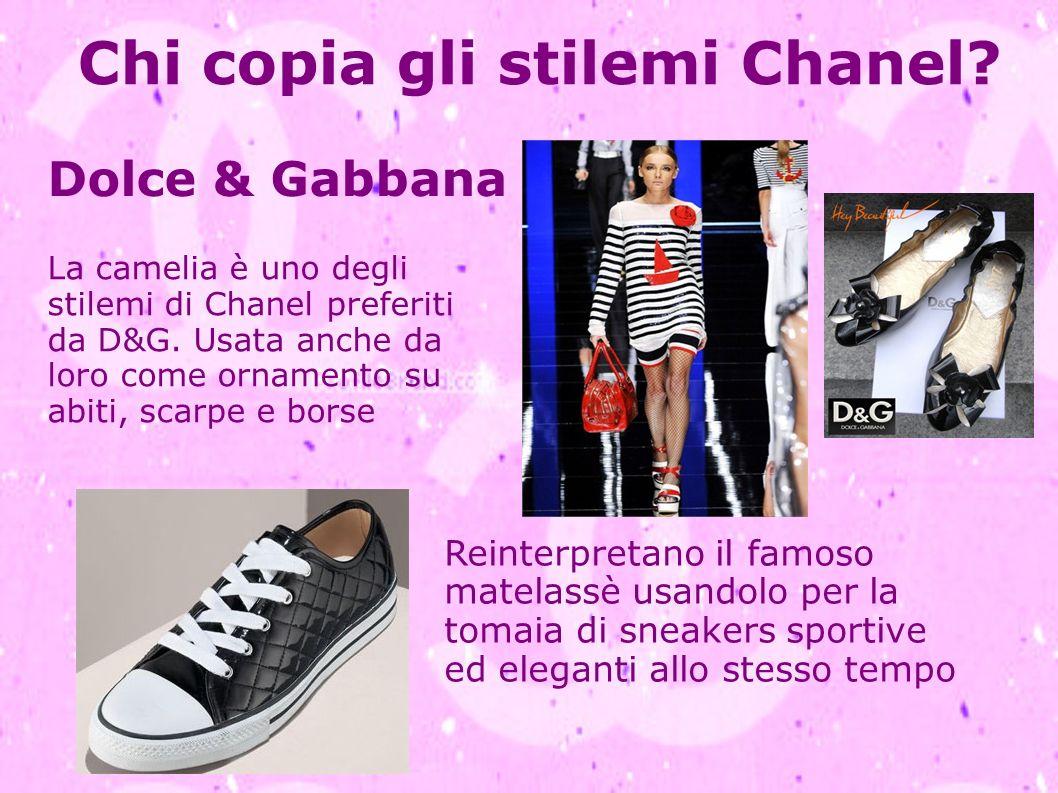 Chi copia gli stilemi Chanel? La camelia è uno degli stilemi di Chanel preferiti da D&G. Usata anche da loro come ornamento su abiti, scarpe e borse D
