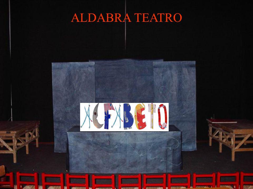 ALFABETO di Marco Gualano regia di Enrico Colombo con Donatella Mora scenografia e libri di Donatella Mora L'alfabeto va in scena!.