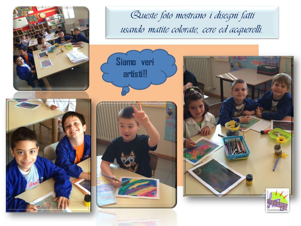Queste foto mostrano i disegni fatti usando matite colorate, cere ed acquerelli. Queste foto mostrano i disegni fatti usando matite colorate, cere ed