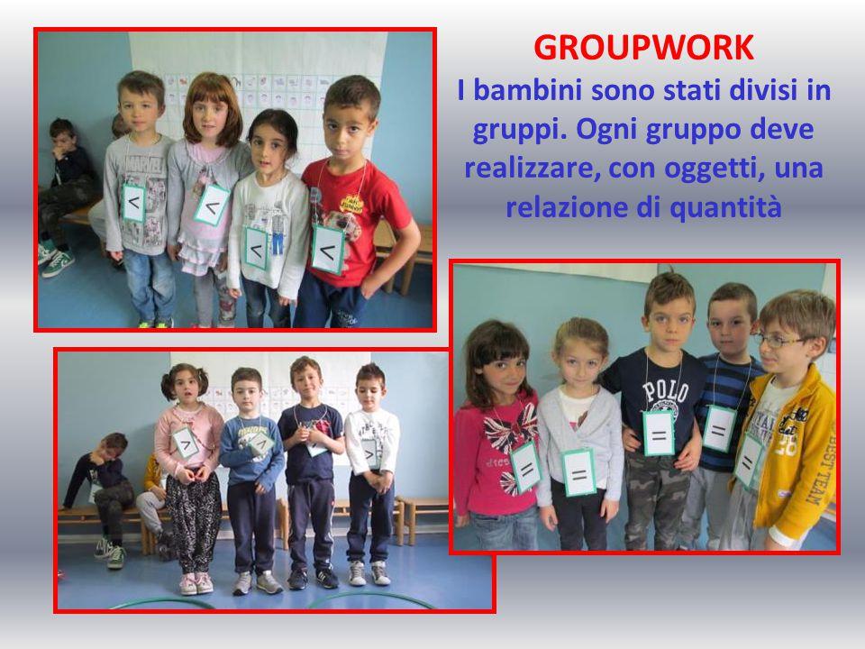 GROUPWORK I bambini sono stati divisi in gruppi. Ogni gruppo deve realizzare, con oggetti, una relazione di quantità