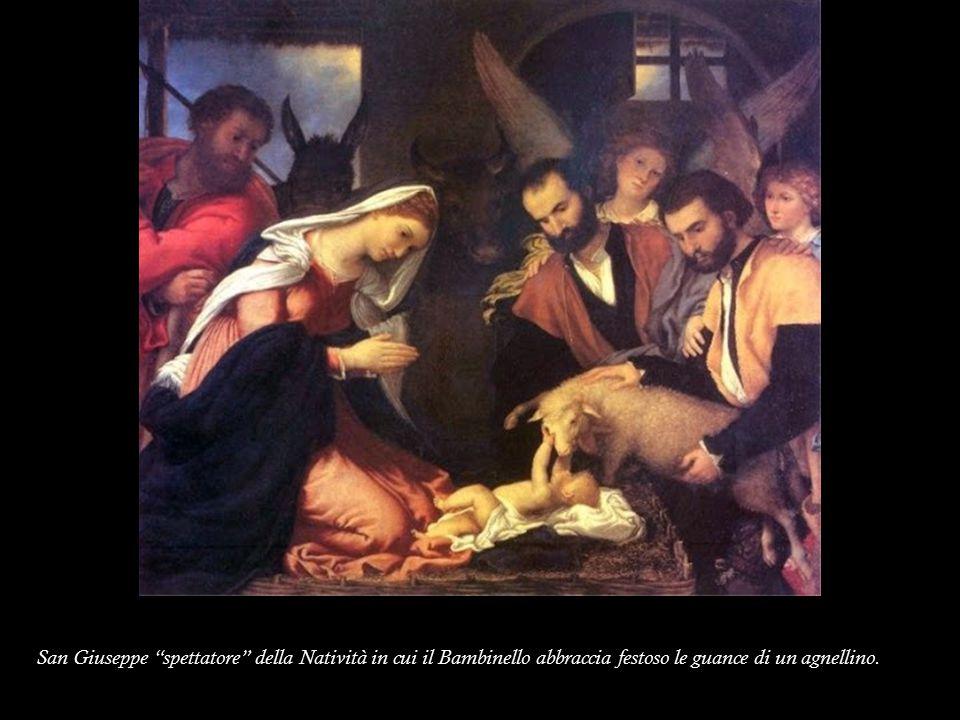 """San Giuseppe """"spettatore"""" della Natività in cui il Bambinello abbraccia festoso le guance di un agnellino."""