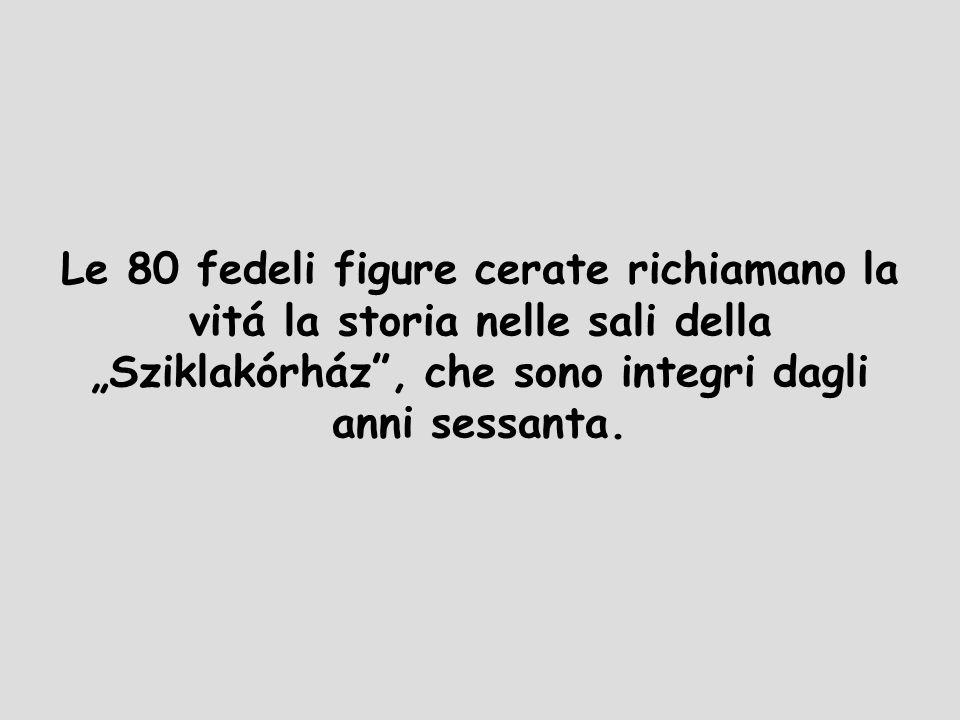 """Le 80 fedeli figure cerate richiamano la vitá la storia nelle sali della """"Sziklakórház , che sono integri dagli anni sessanta."""