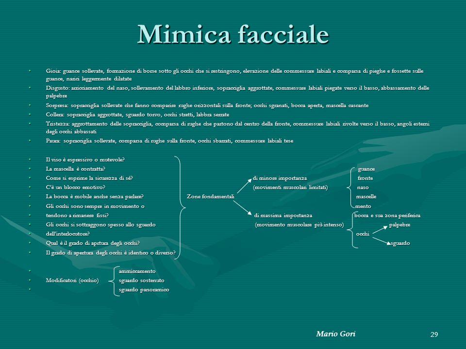 Mario Gori 29 Mimica facciale Gioia: guance sollevate, formazione di borse sotto gli occhi che si restringono, elevazione delle commessure labiali e c
