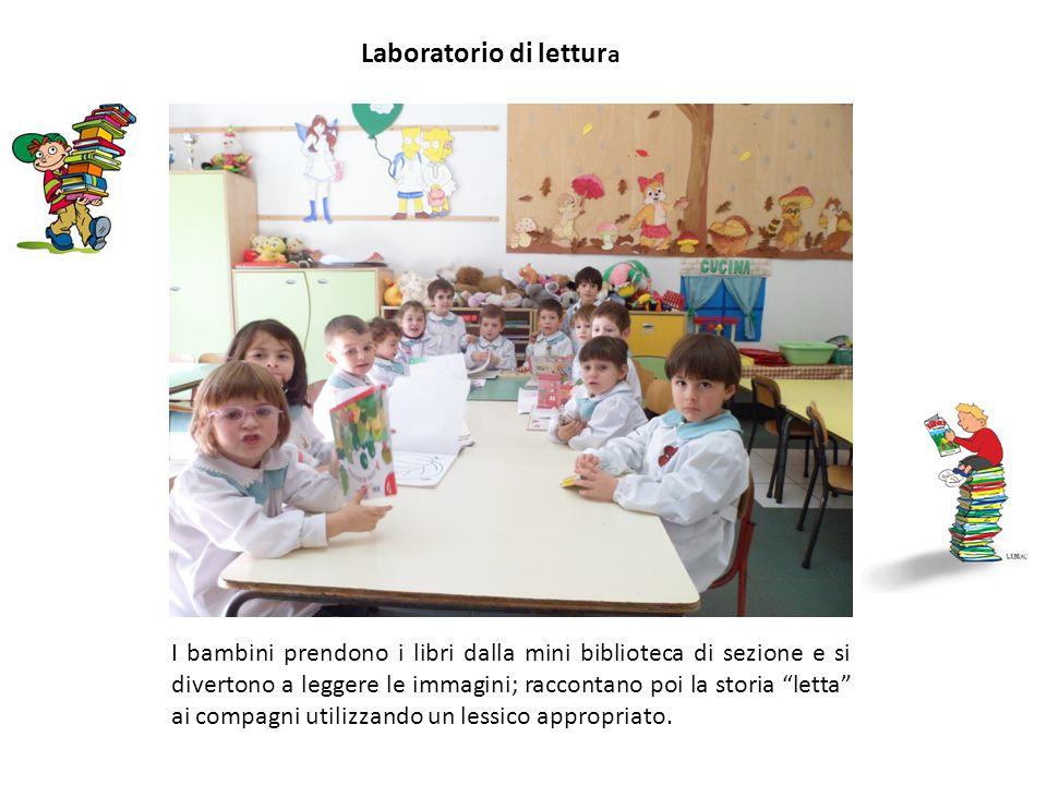 """Laboratorio di lettur a I bambini prendono i libri dalla mini biblioteca di sezione e si divertono a leggere le immagini; raccontano poi la storia """"le"""