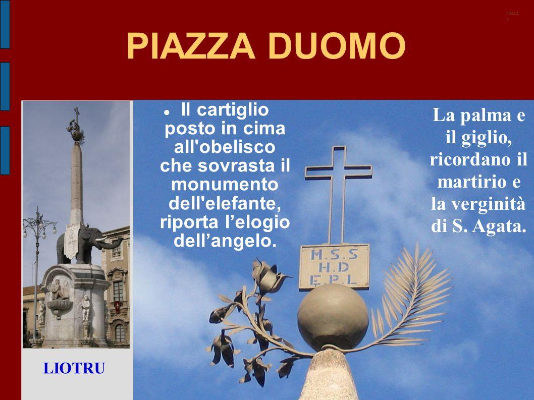 PIAZZA DUOMO Il cartiglio posto in cima all'obelisco che sovrasta il monumento dell'elefante, riporta l'elogio dell'angelo. La palma e il giglio, rico