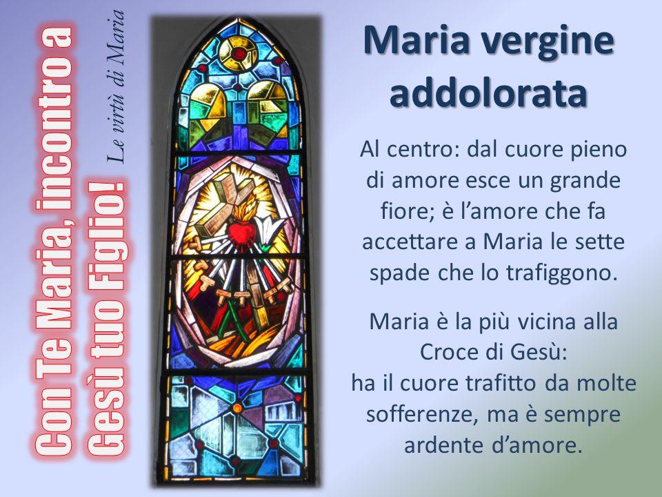 Maria vergine addolorata Al centro: dal cuore pieno di amore esce un grande fiore; è l'amore che fa accettare a Maria le sette spade che lo trafiggono