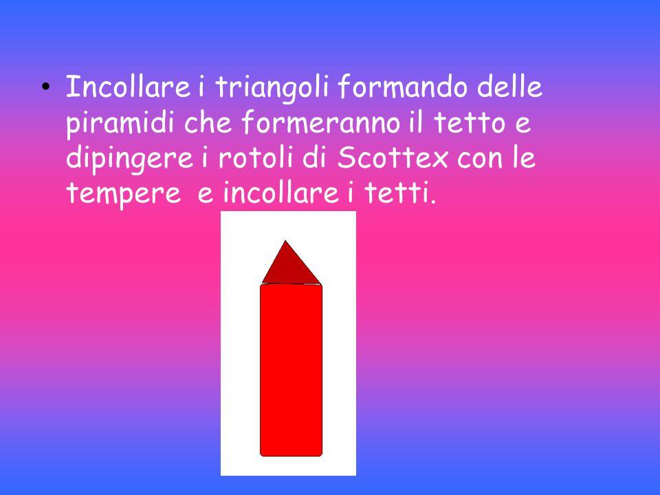 Incollare i triangoli formando delle piramidi che formeranno il tetto e dipingere i rotoli di Scottex con le tempere e incollare i tetti.