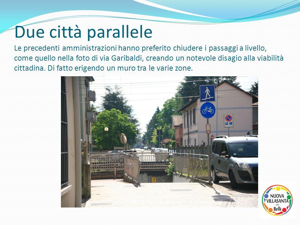 Due città parallele Le precedenti amministrazioni hanno preferito chiudere i passaggi a livello, come quello nella foto di via Garibaldi, creando un n