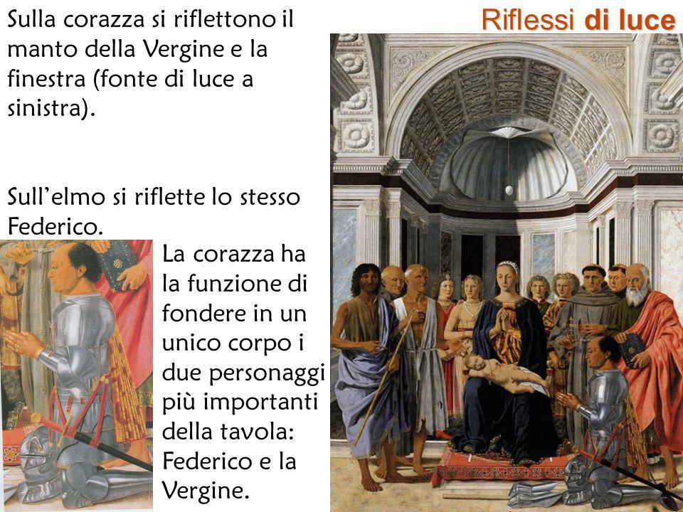 Riflessi di luce Sulla corazza si riflettono il manto della Vergine e la finestra (fonte di luce a sinistra). Sull'elmo si riflette lo stesso Federico