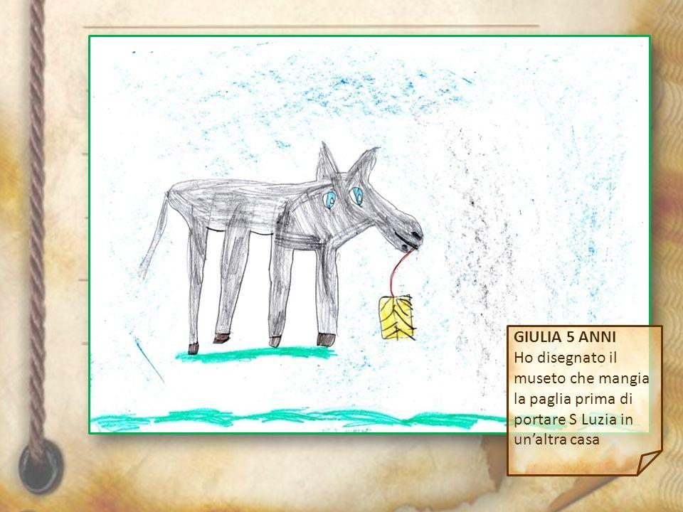 GIULIA 5 ANNI Ho disegnato il museto che mangia la paglia prima di portare S Luzia in un'altra casa