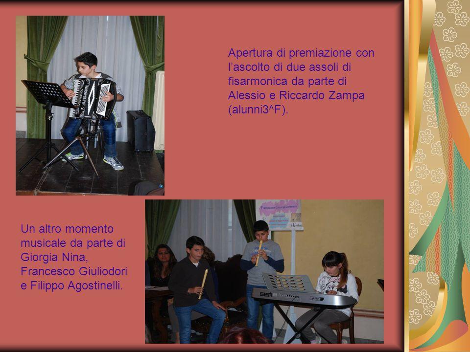 Apertura di premiazione con l'ascolto di due assoli di fisarmonica da parte di Alessio e Riccardo Zampa (alunni3^F). Un altro momento musicale da part