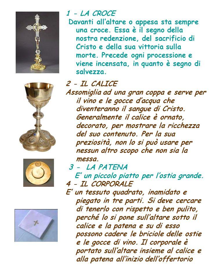 1 - LA CROCE Davanti all'altare o appesa sta sempre una croce. Essa è il segno della nostra redenzione, del sacrificio di Cristo e della sua vittoria