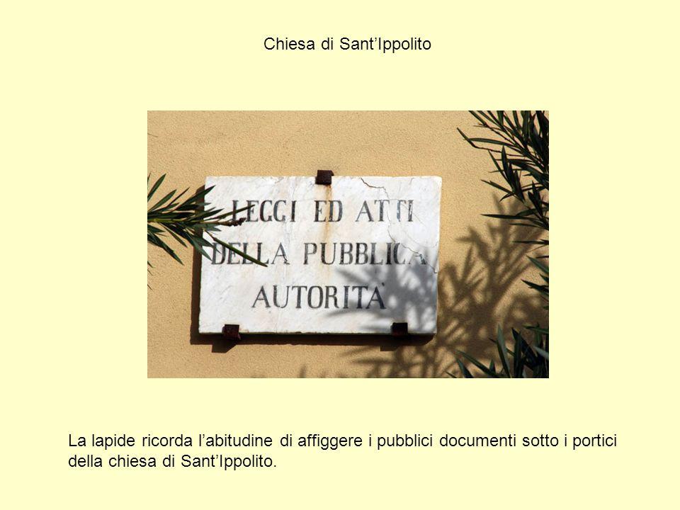 Chiesa di Sant'Ippolito La lapide ricorda l'abitudine di affiggere i pubblici documenti sotto i portici della chiesa di Sant'Ippolito.