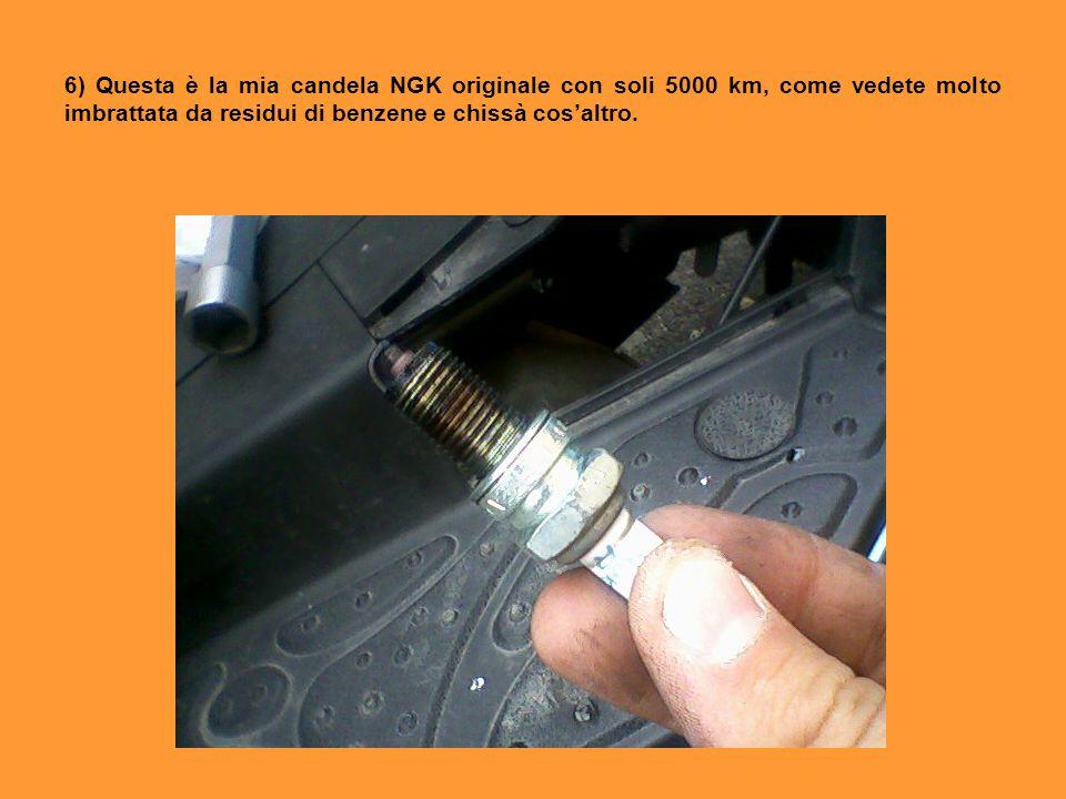 6) Questa è la mia candela NGK originale con soli 5000 km, come vedete molto imbrattata da residui di benzene e chissà cos'altro.