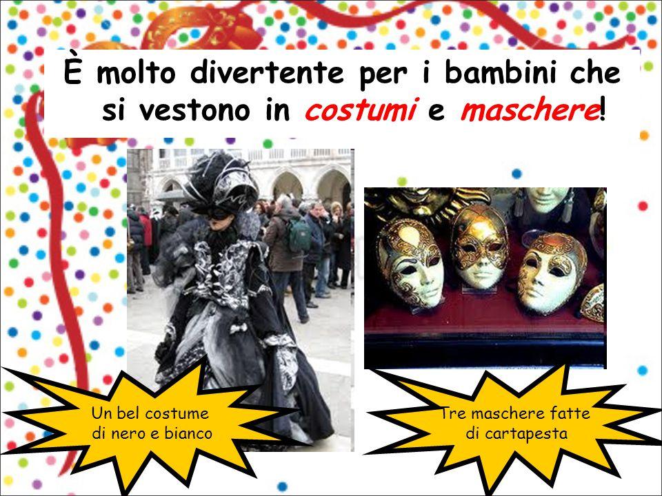 È molto divertente per i bambini che si vestono in costumi e maschere! Un bel costume di nero e bianco Tre maschere fatte di cartapesta