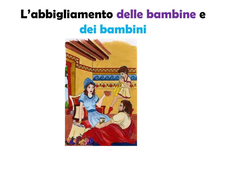 Bambine e bambine etrusche Le bambine etrusche come le mamme portavano il berretto a punta e indossavano una sottoveste, una tunica e una mantella leggera di colore bianco.