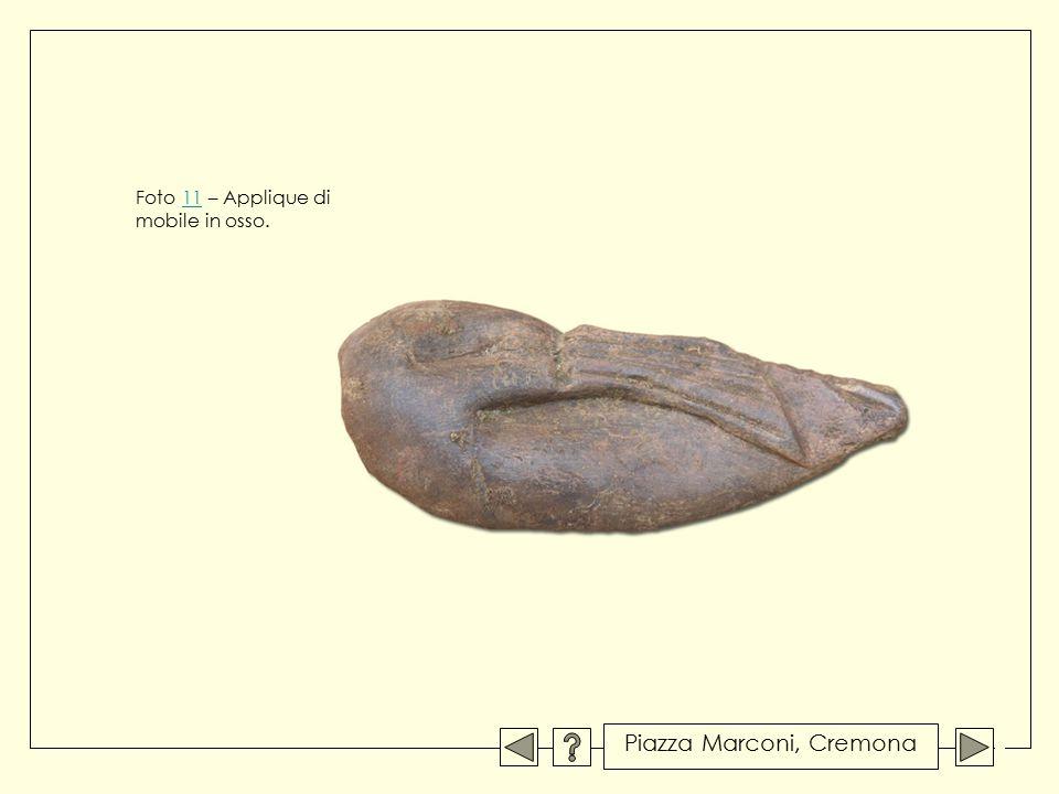 Foto 11 – Applique di11 mobile in osso. Piazza Marconi, Cremona