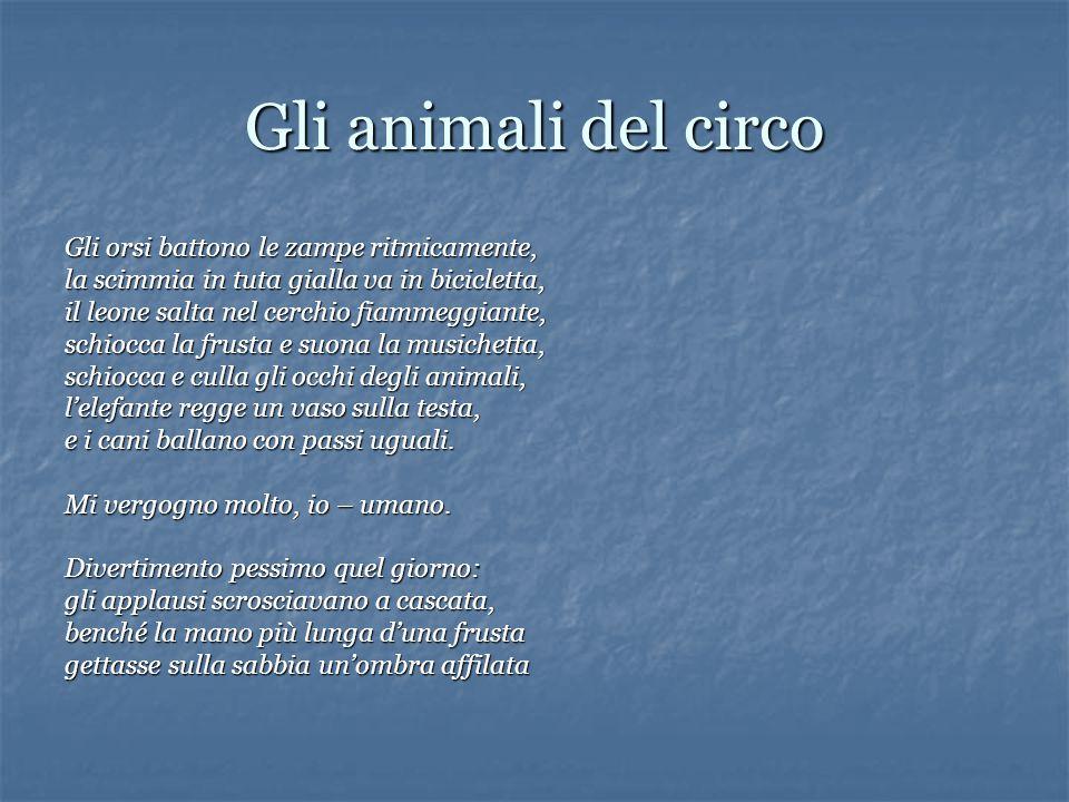 Gli animali del circo Gli orsi battono le zampe ritmicamente, la scimmia in tuta gialla va in bicicletta, il leone salta nel cerchio fiammeggiante, sc