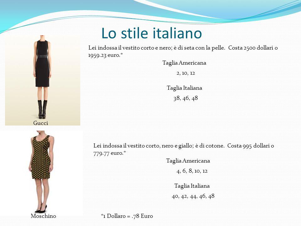 Lo stile italiano Gucci Moschino Lei indossa il vestito corto e nero; è di seta con la pelle. Costa 2500 dollari o 1959.23 euro.* Taglia Americana 2,