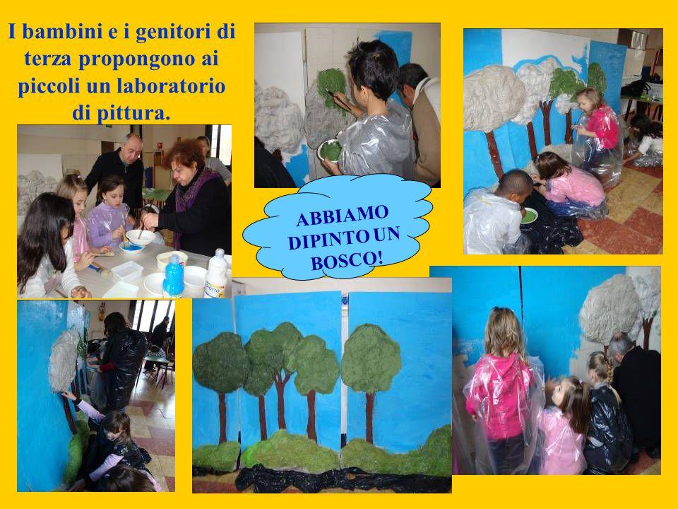 I bambini e i genitori di terza propongono ai piccoli un laboratorio di pittura. ABBIAMO DIPINTO UN BOSCO!