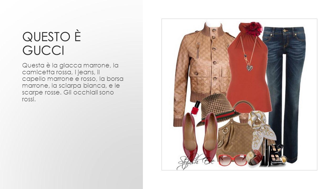 QUESTO È GUCCI Questa è la giacca marrone, la camicetta rossa, i jeans, il capello marrone e rosso, la borsa marrone, la sciarpa bianca, e le scarpe r