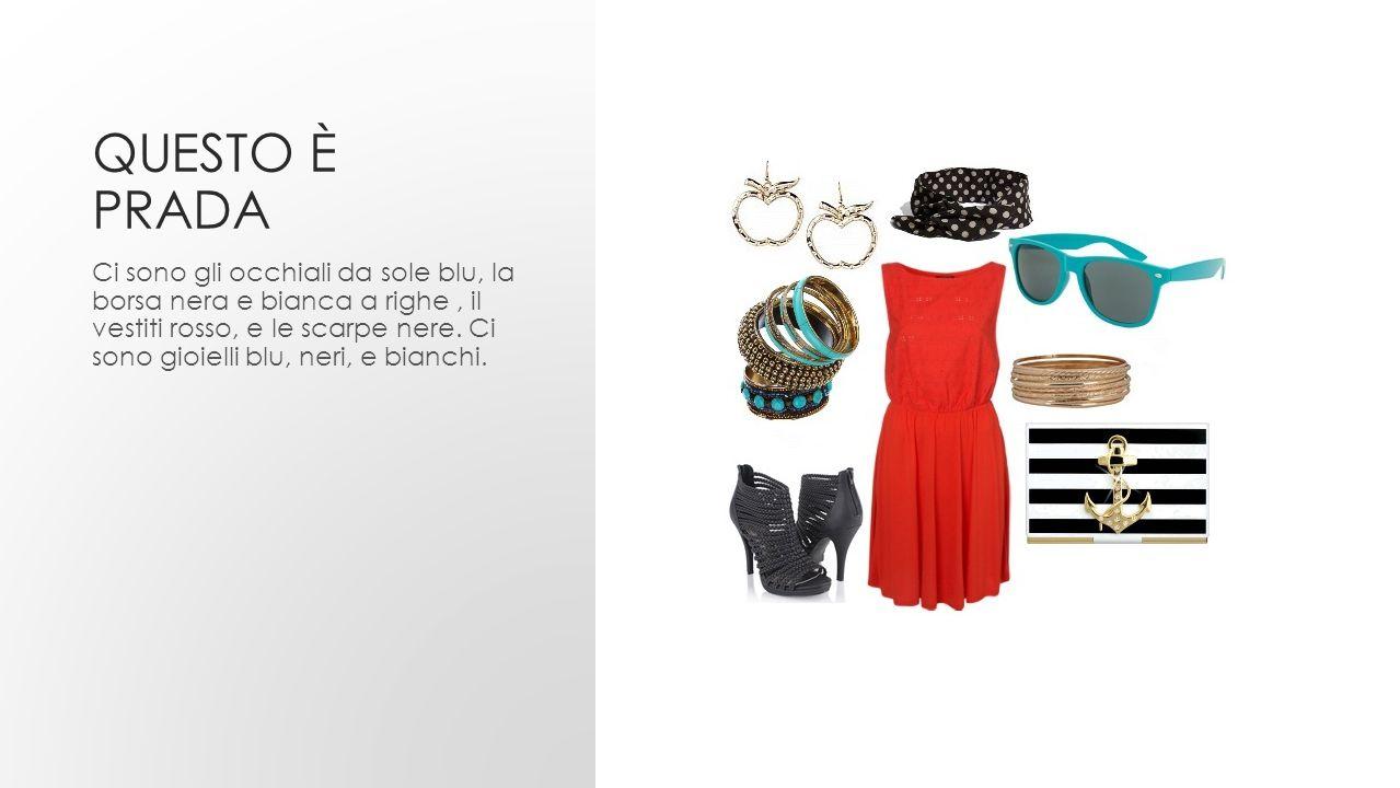 QUESTO È PRADA Ci sono gli occhiali da sole blu, la borsa nera e bianca a righe, il vestiti rosso, e le scarpe nere. Ci sono gioielli blu, neri, e bia