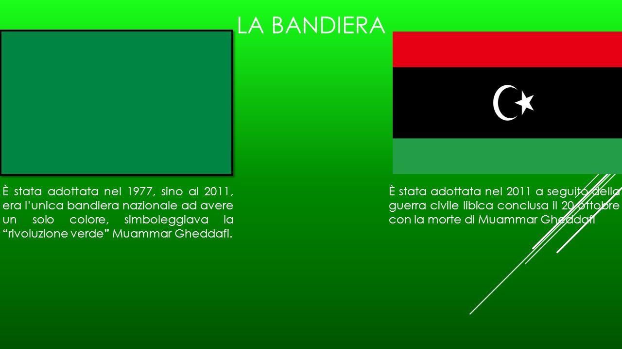 LA BANDIERA È stata adottata nel 1977, sino al 2011, era l'unica bandiera nazionale ad avere un solo colore, simboleggiava la rivoluzione verde M uammar Gheddafi.