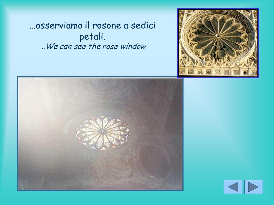 …osserviamo il rosone a sedici petali. …We can see the rose window