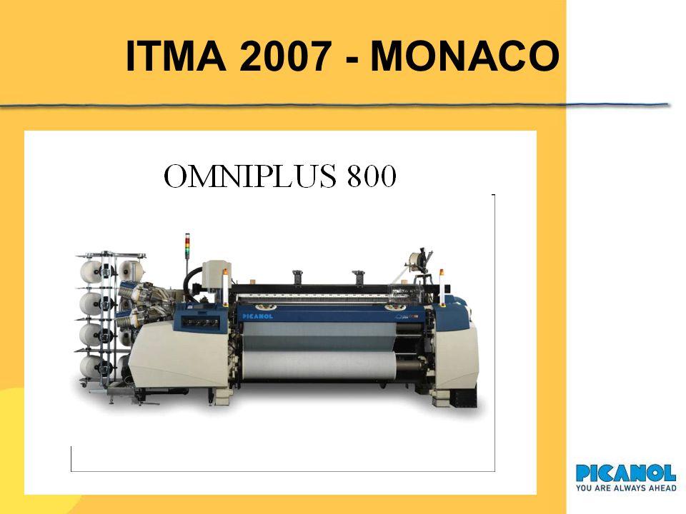 ITMA 2007 - MONACO Macchina a pinze OptiMax 6-R 220: drapperia (stand Stäubli) 6 colori, ratiera, altezza pettine 220 cm CatenatitoloNm 72/2 materiale