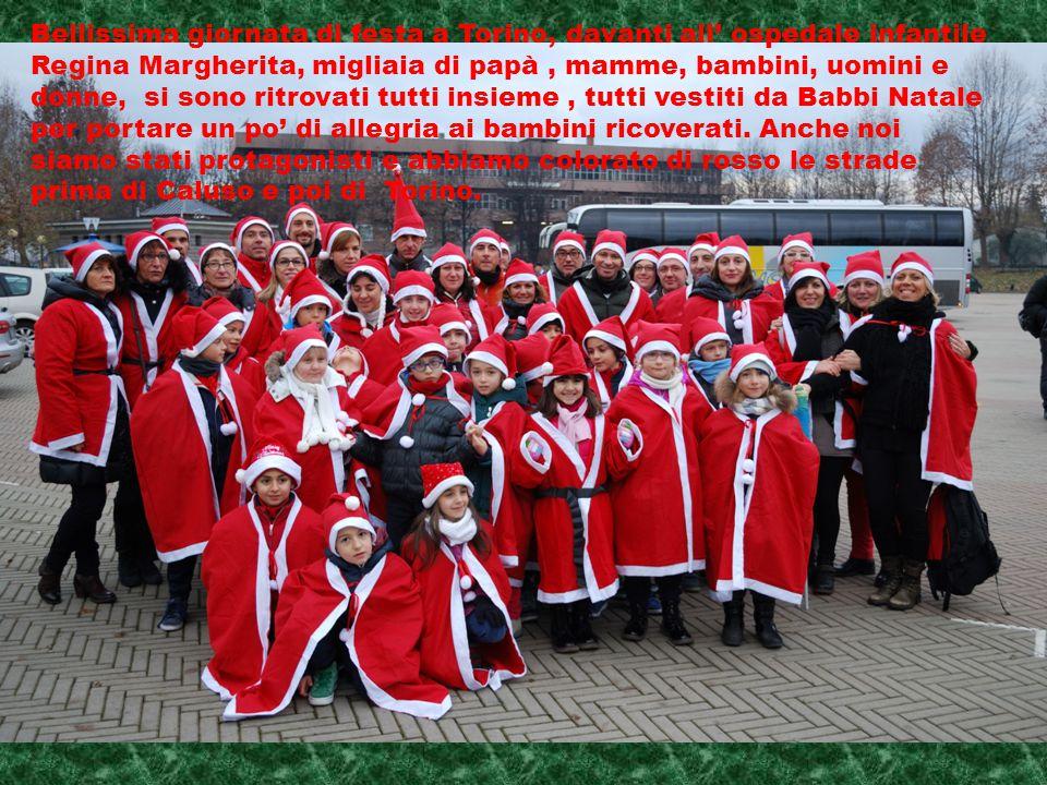 Bellissima giornata di festa a Torino, davanti all' ospedale infantile Regina Margherita, migliaia di papà, mamme, bambini, uomini e donne, si sono ritrovati tutti insieme, tutti vestiti da Babbi Natale per portare un po' di allegria ai bambini ricoverati.