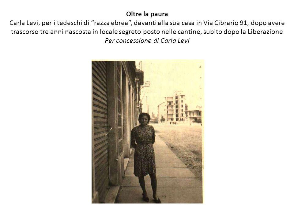 """Oltre la paura Carla Levi, per i tedeschi di """"razza ebrea"""", davanti alla sua casa in Via Cibrario 91, dopo avere trascorso tre anni nascosta in locale"""