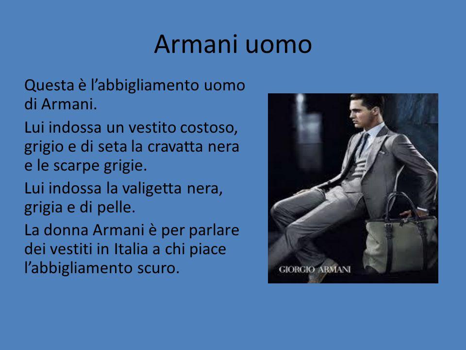 Armani uomo Questa è l'abbigliamento uomo di Armani. Lui indossa un vestito costoso, grigio e di seta la cravatta nera e le scarpe grigie. Lui indossa
