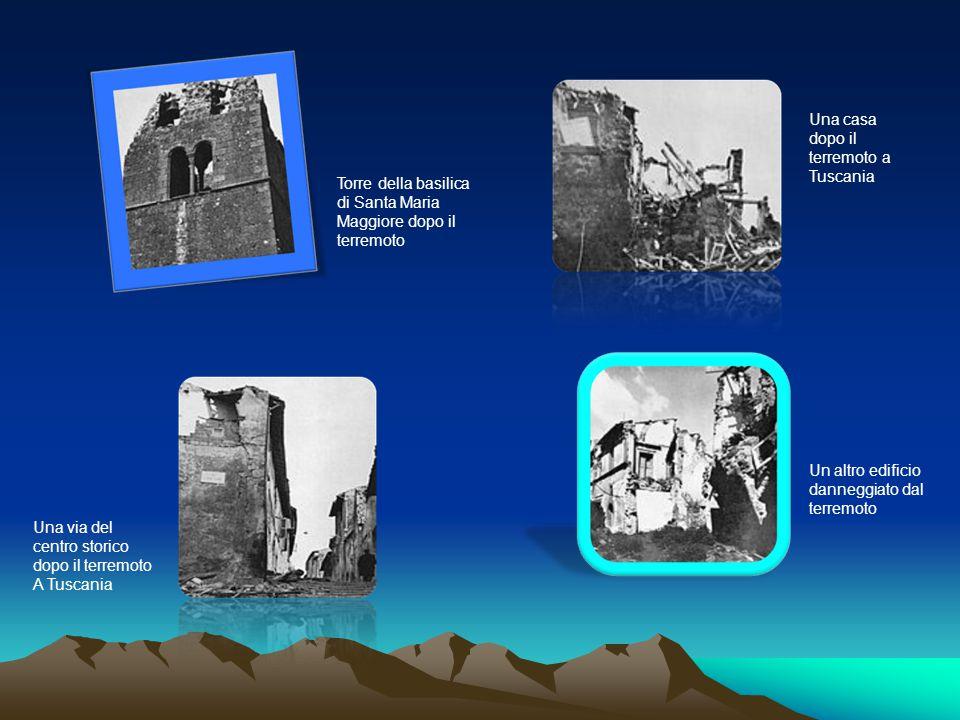 Una casa dopo il terremoto a Tuscania Torre della basilica di Santa Maria Maggiore dopo il terremoto Una via del centro storico dopo il terremoto A Tuscania Un altro edificio danneggiato dal terremoto