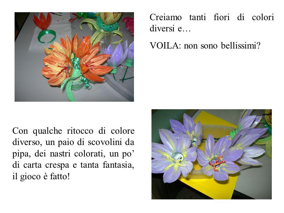 Creiamo tanti fiori di colori diversi e… VOILA: non sono bellissimi? Con qualche ritocco di colore diverso, un paio di scovolini da pipa, dei nastri c