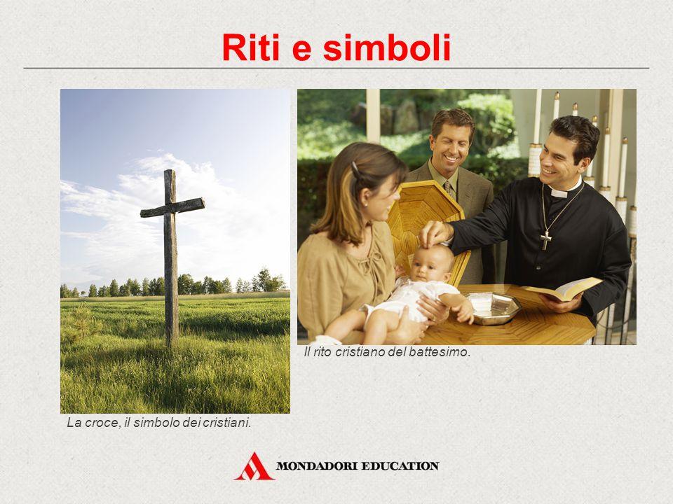 La croce, il simbolo dei cristiani. Riti e simboli Il rito cristiano del battesimo.