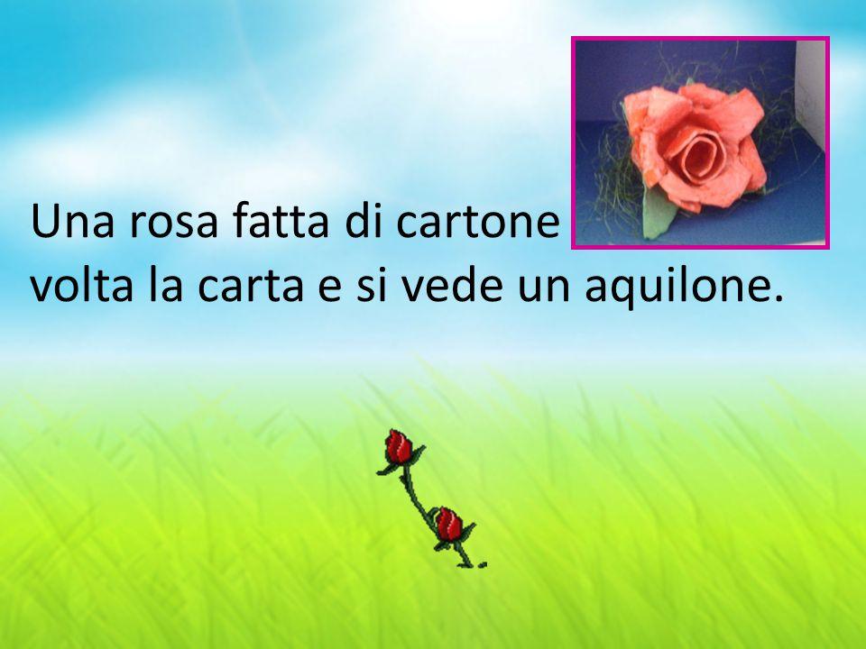 Una rosa fatta di cartone volta la carta e si vede un aquilone.