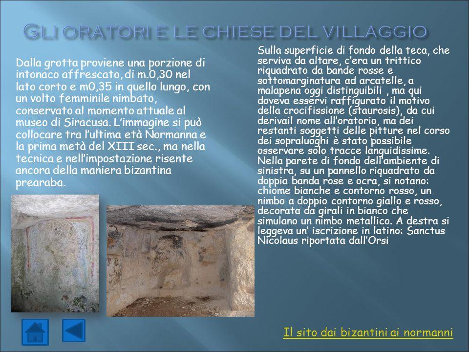 Dalla grotta proviene una porzione di intonaco affrescato, di m.0,30 nel lato corto e m0,35 in quello lungo, con un volto femminile nimbato, conservat