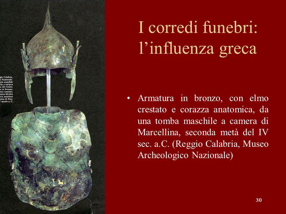 30 I corredi funebri: l'influenza greca Armatura in bronzo, con elmo crestato e corazza anatomica, da una tomba maschile a camera di Marcellina, secon